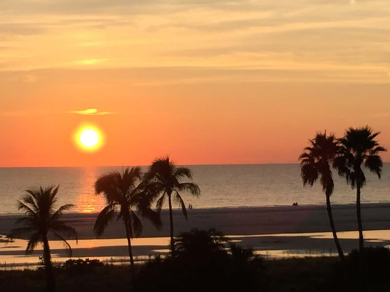 Marco Island Beachfront Properties with a Sunset